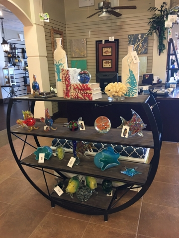 round shelf with glass fish decor