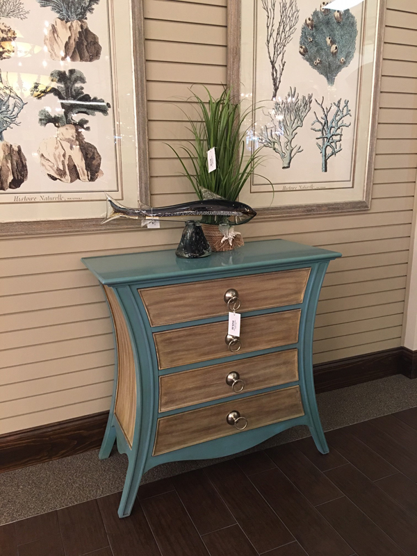 teal and wood cabinet